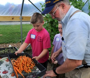 Children at George Washington School develop a love of gardening, then get their whole family gardening at home, Putnam Extension agent Chuck Talbott said.