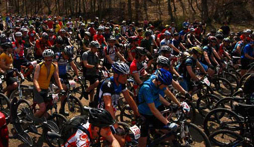 Mountain biking now brings thousands of people and more thousands of dollars to West Virginia. Here, mountain bikers line up for the start of the Mountwood race, one of more than 25 major West Virginia races.